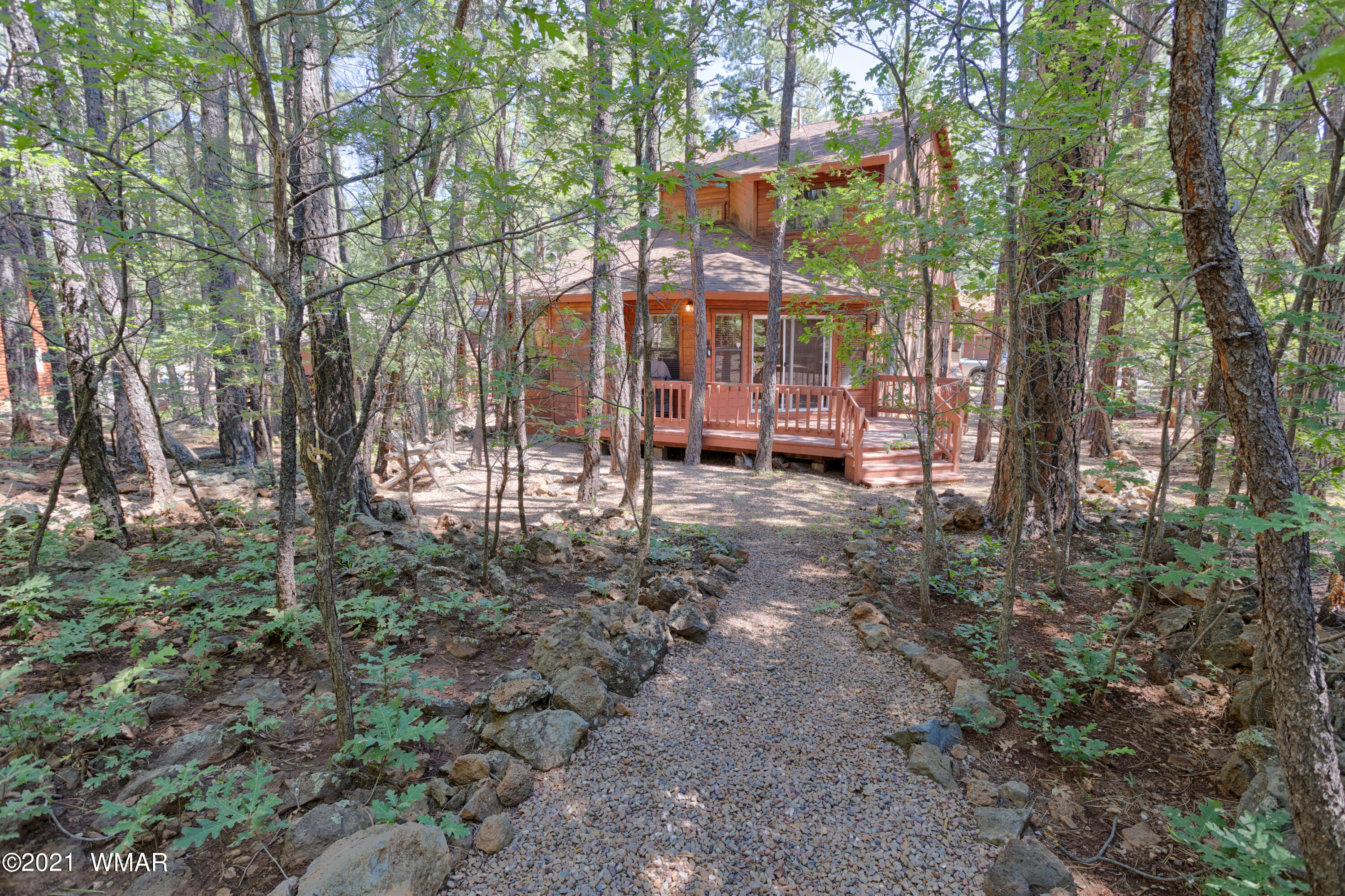 Here it is, a mountain cabin in the trees with loads of space for family to enjoy the cool mountain lifestyle.  3 BR, 2.5 BA with a two-car garage has an open great room floor plan that leads to a deck that sits in a yard of tall Pines and Oaks.  Plus home is located in the Pinetop Lakes Recreation Community which includes:  family events, a club house, pool, jacuzzi, fitness center, tennis and pickleball courts, children's play area. HOA is only $335/year.  There is natural gas available however house is all electric.