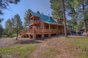 Custom Home on treed acreage