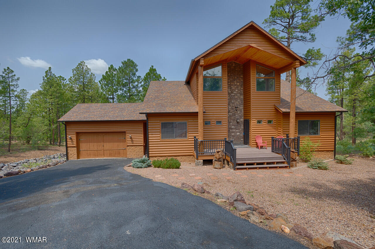 Outstanding cabin in Pinetop, AZ!  One of a kind, tree- top views for miles.   This home boasts so much space!! Three bedrooms on the main floor, incredible huge loft, a walk out finished basement wtih two large rooms that could be used as bedrooms, game room, upscale kitchen with granite and stainless steel appliances....  Triple level back decks.   Sellers have done so many upgrades to this home: roof replaced 2020, re-stained the whole house Aug 2021, replaced decking and columns in back, added foundational support for future addition to master bedroom, added french drains... Being sold furnished.  HOA is $240 per year.