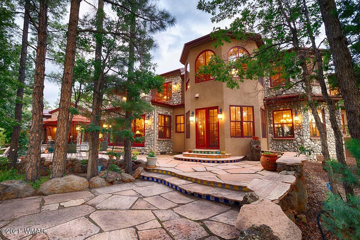 Escape-explore-relax in this 4-season mountain setting. Unique 11.3 acre property, custom 7800 sq. ft. luxury home, nestled in the Ponderosa pine forest. 300' of rare lake frontage, incredible views of Rainbow Lake with beautifully-landscaped outdoor living space. Bedroom wing with 4 rooms with en-suite baths, upstairs master suite and loft, gourmet kitchen, tall cathedral ceilings in great room with stone fireplace and massive elk antler chandelier. Privately-gated, guest house, potential horse property, secluded yet close to shopping, winter skiing, fishing, hunting, hiking.