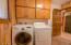 nice size laundry room by kitchen and master with cabinets for storage