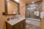 spare full bathroom off kitchen for easy access
