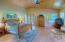 Master Bedroom/doors leading to covered deck