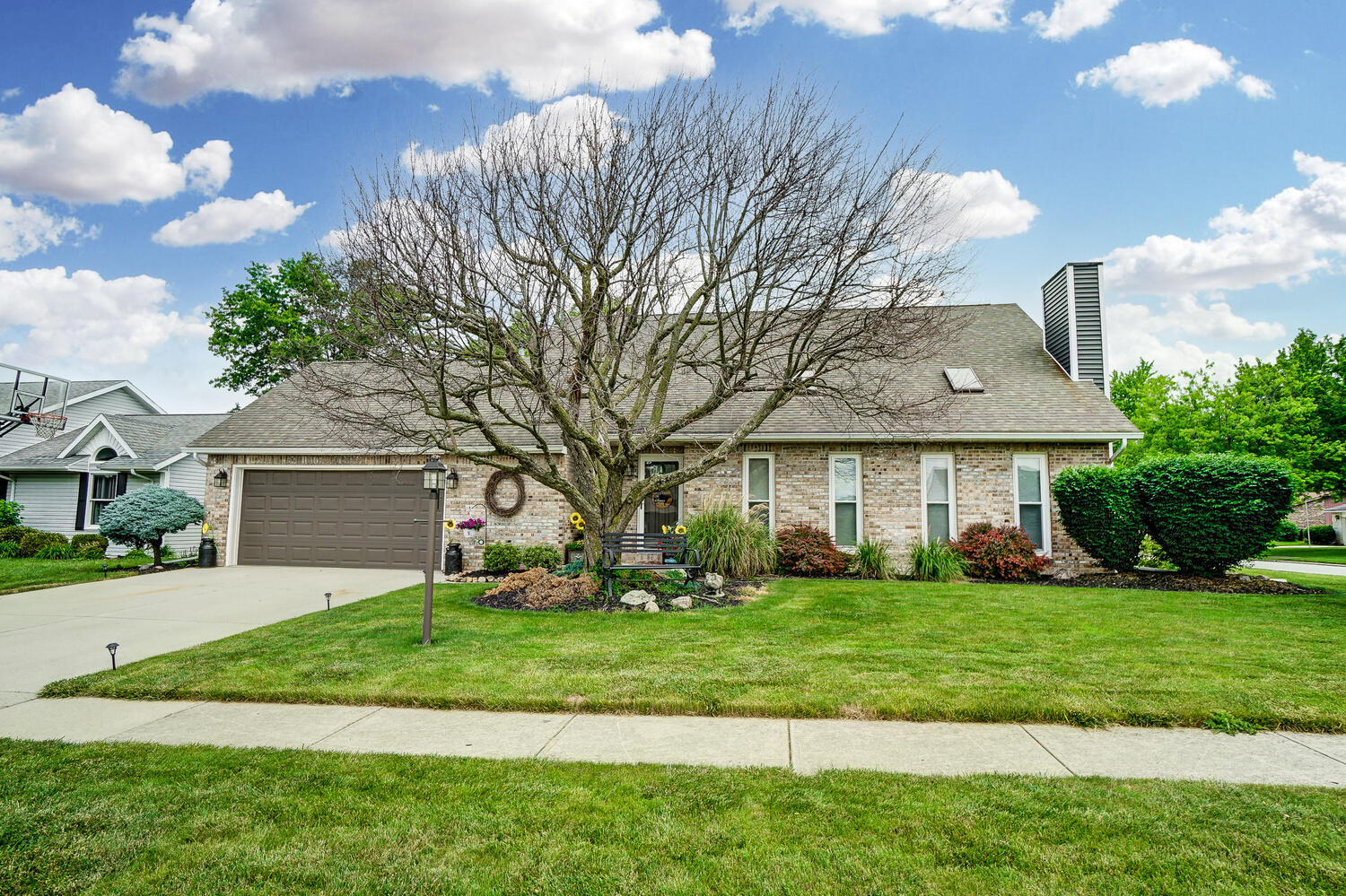Enjoy your summer in this beautifully maintained home.  This home is ready to move into with many recent updates: Paint throughout, Flooring 2020, Light fixtures 2020, Windows & Siding 2019, Front door & Patio door 2019, Stainless appliances 2018, Master bath venting 2021, Updated landscaping including raised garden beds 2021, Kitchen backsplash 2021.  Spacious and comfortable with two living areas, eat-in kitchen and partial basement finish.  Living room offers vaulted ceiling.  Private, first floor master suite.  Backyard hosts a large deck for relaxation or entertaining.  Conveniently located in Sherwood Park. 1)Square footage per Allen County Auditor. Room Sizes are approximate  Buyer's agent to attend all showings and inspections.