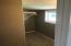 walk-in closet for the upstairs bedroom