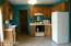 Fully applianced kitchen featuring Keller Cabinets, ceiling fan and ceramic flooring.