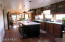 Kitchen has cherry cupboards, pantry and center island, appliances all stay