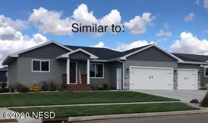 Photo is of a home similar to this one with landscape, etc completed.